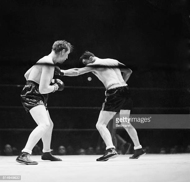 Jim Braddock lands a long left to Tommy Farr's chest in their tenround bout at Madison Square Garden New York City January 21 1938 With a last round...