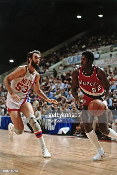 Jim Brewer of the Portland Trailblazers dribbles against the New Jersey Nets during a game played circa 1975 at the Rutgers Athletic Center in...