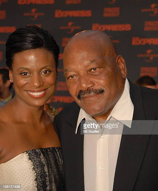 """Jim Brown and his wife Monique attend the world premiere of """"The Express"""" at the Landmark Theater on September 12, 2008 in Syracuse, New York."""