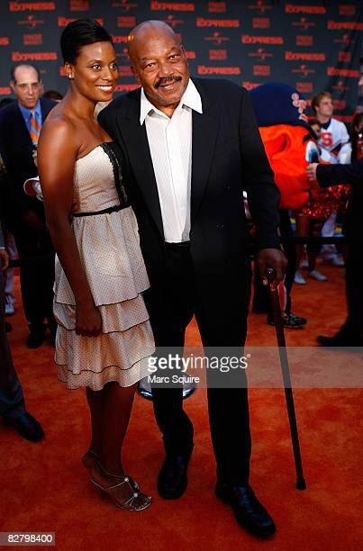Jim Brown and wife walk the orange carpet during the world premiere of The Express at the Landmark Theatre on September 12 2008 in Syracuse New York