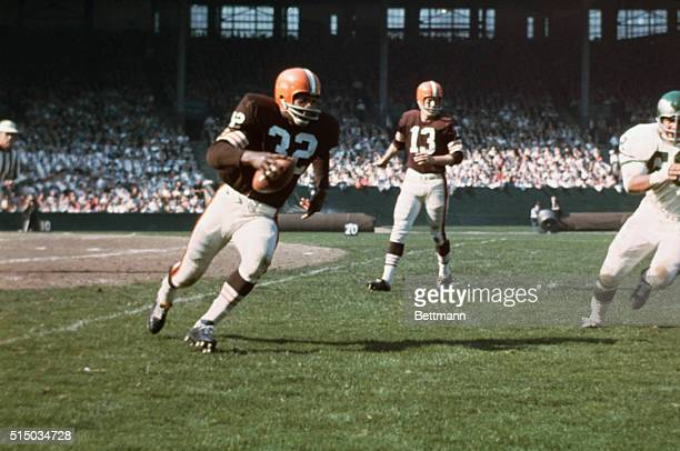 Jim Brown has just taken hand off from Quarterback Frank Ryan in game against the Philadelphia Eagles.