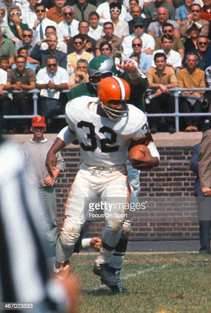 Jim Brown of the Cleveland Browns carries the ball against the Philadelphia Eagles during an NFL football game September 24 1964 at Franklin Field in...