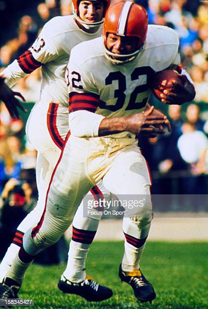Jim Brown of the Cleveland Browns carries the ball against the New York Giants during an NFL football game circa 1964 at Yankee Stadium in the Bronx...