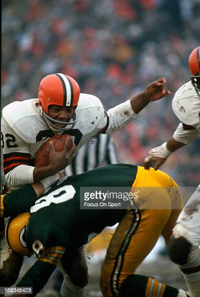 Jim Brown of the Cleveland Browns gets hits by Dave Robinson of the Green Bay Packers during an NFL football game November 22 1964 at Lambeau Field...