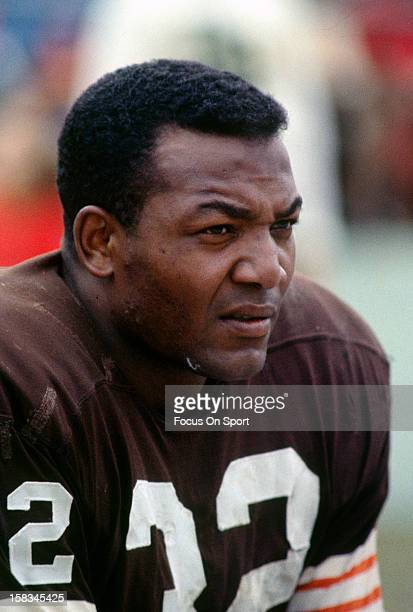Jim Brown of the Cleveland Browns look on from the sidelines during an NFL football game circa 1964 at Cleveland Municipal Stadium in Cleveland Ohio...
