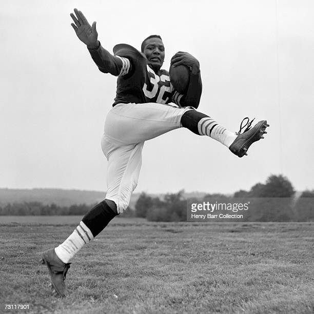 Jim Brown of the Cleveland Browns poses for an action portrait during training camp in July 24 1958 at Hiram College in Hiram Ohio
