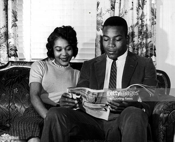 Jim Brown Syracuse University halfback and his girlfriend Henrietta Creech check an AllAmerica story honoring Brown in Collier's magazine circa 1956
