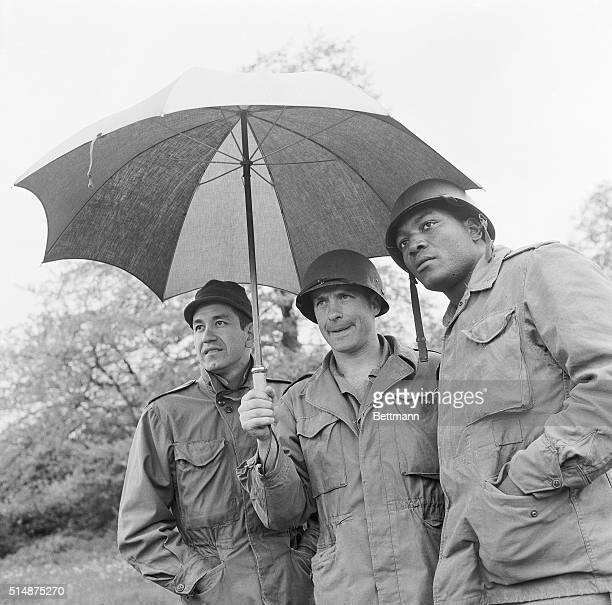 Jim Brown Trini Lopez and John Cassavetes on a rainy set of The Dirty Dozen in England This was Brown's first film Cassavetes was nominated for an...