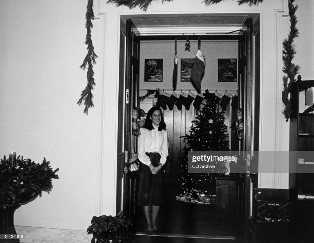 office decorator social work ashley mcarthur standing at door during christmas pictures getty
