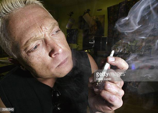 Jim Brydges a medical marijuana exemptee who is living with HIV/AIDS smokes marijuana June 2 2003 at a Toronto Hemp Store Brydges can legally poses...
