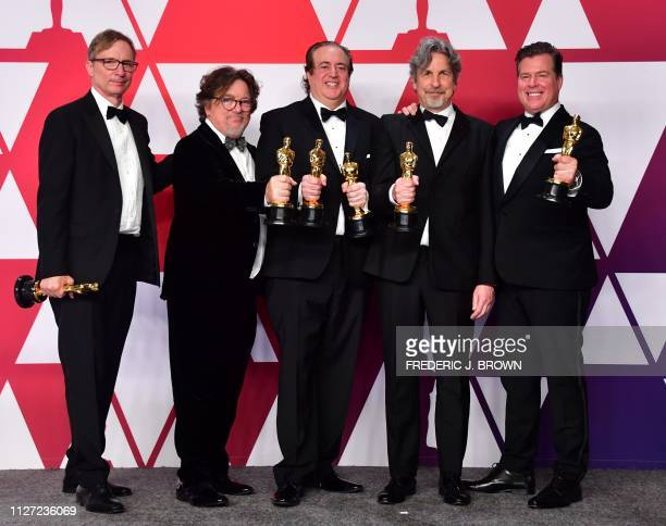 Jim Burke Charles B Wessler Nick Vallelonga Peter Farrelly and Brian Currie winners of Best Picture for 'Green Book' pose in the press room during...