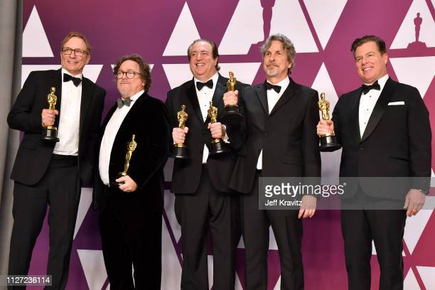 Jim Burke Charles B Wessler Nick Vallelonga Peter Farrelly and Brian Currie pose with the Best Picture and Best Original Screenplay award for Green...