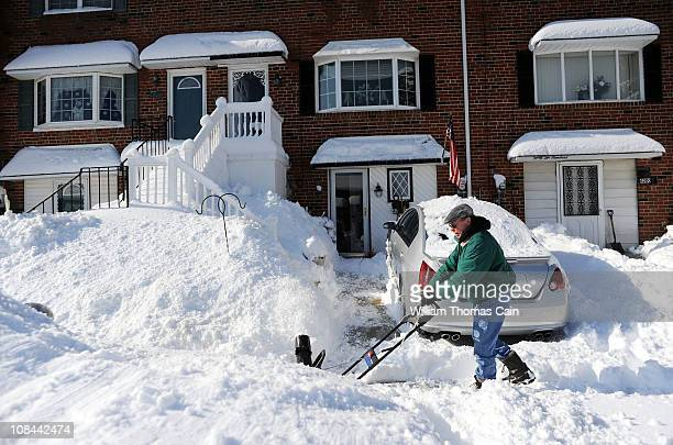 Jim Burke of Philadelphia Pennsylvania uses a snow blower as he digs out from the snow January 27 2011 in Philadelphia Pennsylvania The Philadelphia...