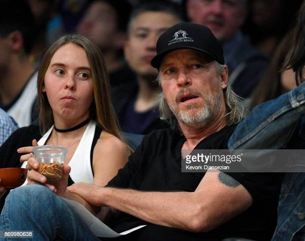 Jim Buss partowner and former executive vice president of basketball operations of the Los Angeles Lakers follows the game from his seat on the...