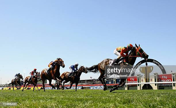 Jim Byrne riding Street Smart wins the Crown Trophy during the 2006 Crown Oaks Day meeting at Flemington Racecourse on November 9 2006 in Melbourne...