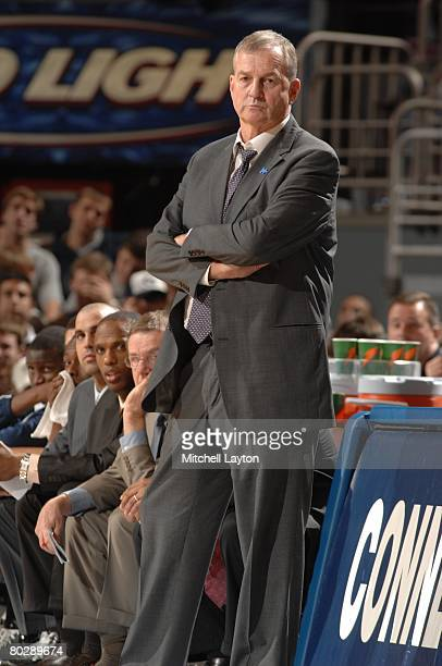 Jim Calhoun, head coach of the Connecticut Huskies, looks on in a game against the West Virginia Mountaineers during the quarterfinals of the Big...