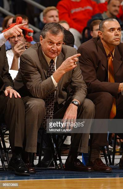 Jim Calhoun, head coach of the Connecticut Huskies, talks to his players during the BB&T Classic Basketball Tournament against the Maryland Terrapins...
