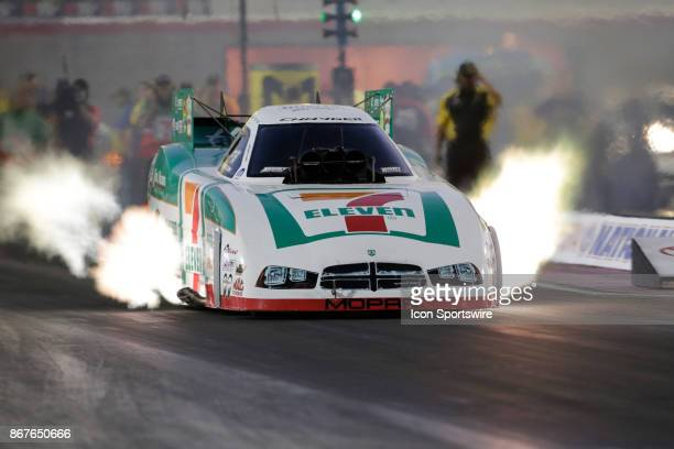 Jim Campbell Dodge Charger NHRA Funny Car races down the track during the NHRA Toyota Nationals on October 28 2017 at The Strip at Las Vegas Motor...