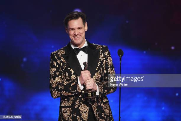 Jim Carrey accepts the Charlie Chaplin Britannia Award for Excellence in Comedy presented by Jaguar Land Rover onstage at the 2018 British Academy...