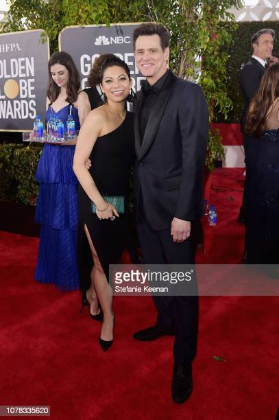 Jim Carrey and Ginger Gonzaga attend FIJI Water at the 76th Annual Golden Globe Awards on January 6 2019 at the Beverly Hilton in Los Angeles...