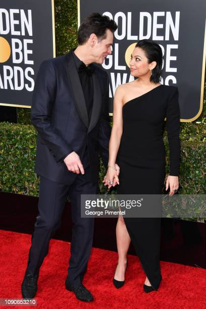 Jim Carrey and Ginger Gonzaga attend the 76th Annual Golden Globe Awards held at The Beverly Hilton Hotel on January 06 2019 in Beverly Hills...