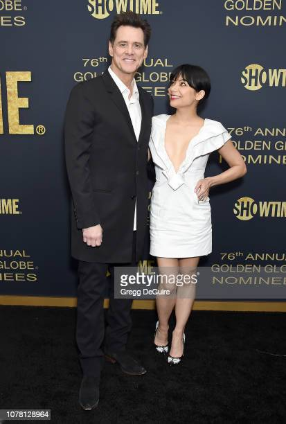Jim Carrey and Ginger Gonzaga attend the Showtime Golden Globe Nominees Celebration at Sunset Tower Hotel on January 5 2019 in West Hollywood...
