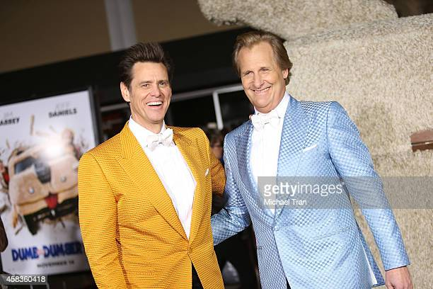Jim Carrey and Jeff Daniels arrive at the Los Angeles premiere of Dumb And Dumber To held at Regency Village Theatre on November 3 2014 in Westwood...