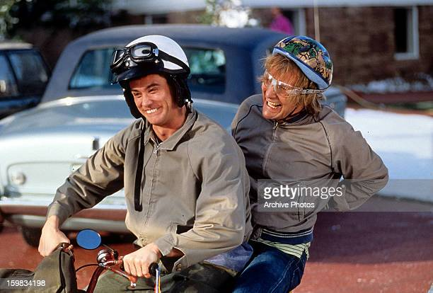 Jim Carrey and Jeff Daniels riding bike in a scene from the film 'Dumb Dumber' 1994