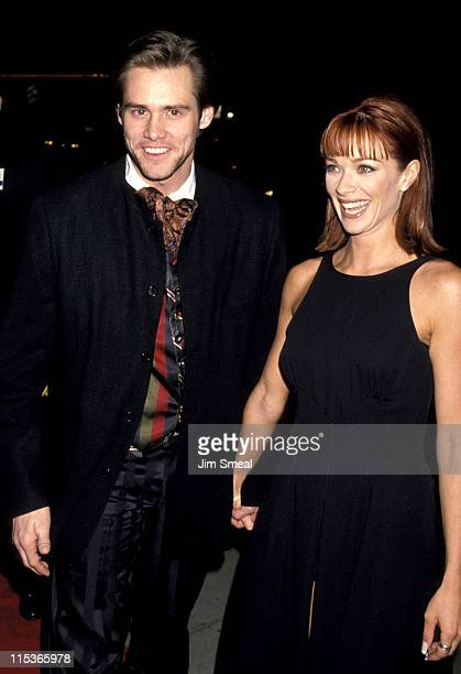 Jim Carrey and Lauren Holly during Dumb and Dumber Hollywood Premiere at Cinerama Dome Theater in Hollywood California United States
