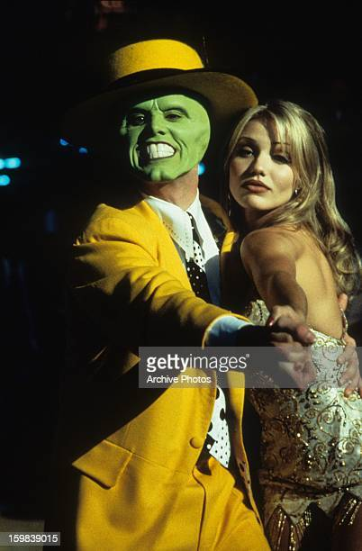 Jim Carrey dancing with Cameron Diaz in a scene from the film 'The Mask', 1994.