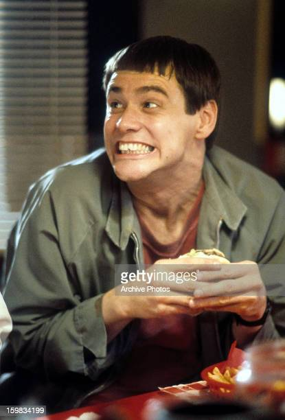 Jim Carrey having burger in a scene from the film 'Dumb & Dumber', 1994.