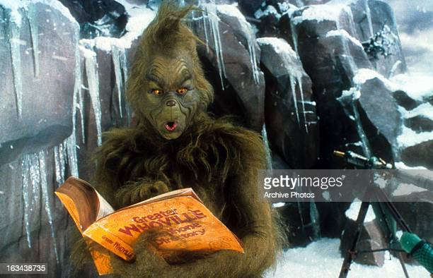 Jim Carrey looking through phone directory in a scene from the film 'How The Grinch Stole Christmas' 2000