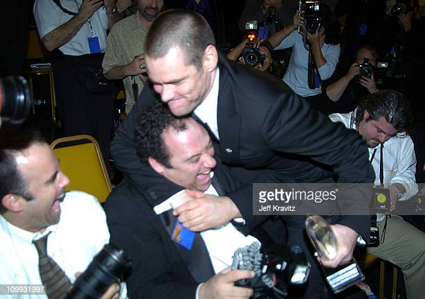 Jim Carrey of Bruce Almighty winner of Favorite Comedy Motion Picture jokes with photographer Steve Granitz in the photo room