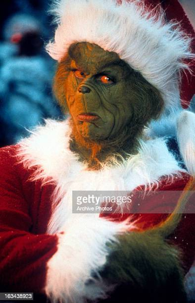 Jim Carrey with arms crossed in a scene from the film 'How The Grinch Stole Christmas' 2000