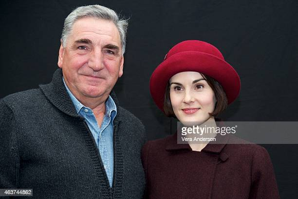 Jim Carter and Michelle Dockery on the 'Downton Abbey' set at Highclere Castle on February 16 2015 in Newbury England
