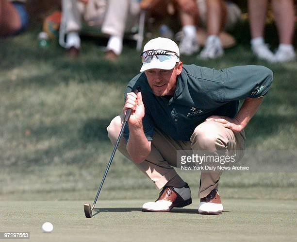 Jim Carter lines up putt on 12 on the third day of the Buick Classic golf tournament