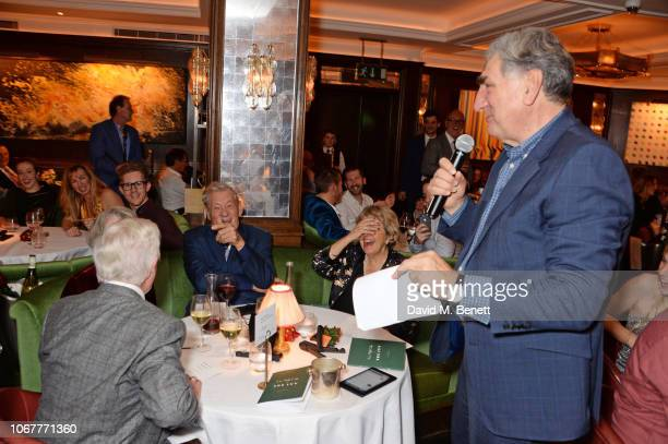 Jim Carter speaks as Sir Derek Jacobi Dame Maggie Smith Sir Ian McKellen and Anne Reid look on at the annual 'One Night Only At The Ivy' in aid of...
