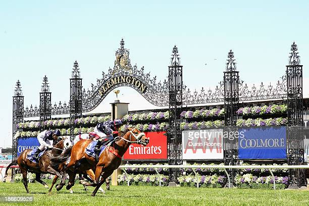 Jim Cassidy riding Zoustar crosses the line to win race 4 the Coolmore Stud Stakes during Derby Day at Flemington Racecourse on November 2 2013 in...