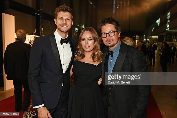Jim Chapman Tanya Burr and Oliver Spencer attend the GQ Men Of The Year Awards 2016 at the Tate Modern on September 6 2016 in London England