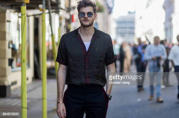 Jim Chapman wearing a button shirt during the London Fashion Week Men's June 2017 collections on June 10 2017 in London England