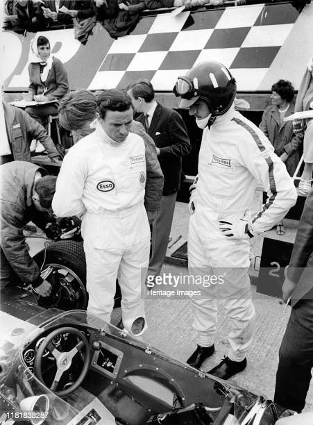 Jim Clark and Graham Hill in pits with Lotus 49 during 1967 British Grand Prix Creator Unknown