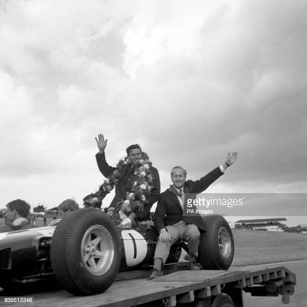 Jim Clark celebrates with Lotus chief Colin Chapman after winning the British Grand Prix at Brands Hatch this afternoon The event was also designated...