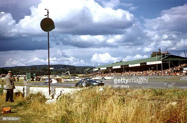 Jim Clark in an Aston Martin DB4GT Zagato at the chicane in the Goodwood Tourist Trophy barrier design in foreground was adopted by slotracing track...