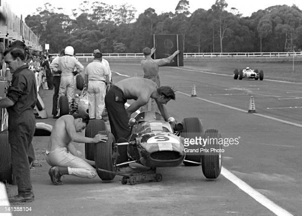 Jim Clark of Great Britain changes the wheel on his Team Lotus Lotus 33 Coventry Climax FWMV V8 20 during practice for the Tasman Cup Series race on...