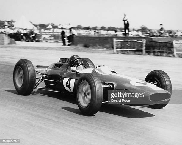 Jim Clark of Great Britain drives the Team Lotus Lotus 25 Climax V8 during the British Grand Prix on 20 July 1963 at the Silverstone circuit near...