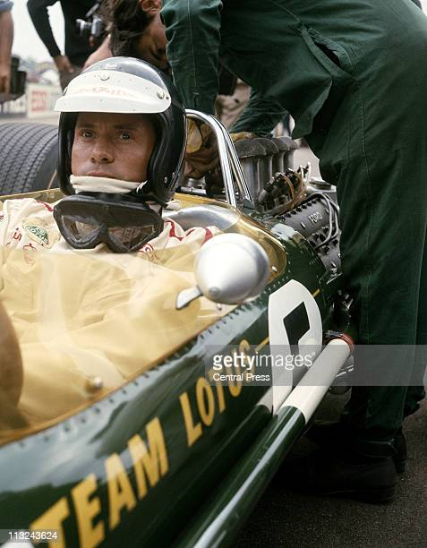 Jim Clark sits aboard the Team Lotus Lotus 49 Ford Cosworth DFV 30 V8 before the start of the British Grand Prix on 15th July 1967 at the Silverstone...