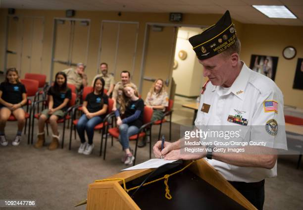 Jim Clements Scout Chairman for VFW Post 6024 in Mission Viejo signs Troop 7272's charter application during a ceremony at Boy Scouts of America's...