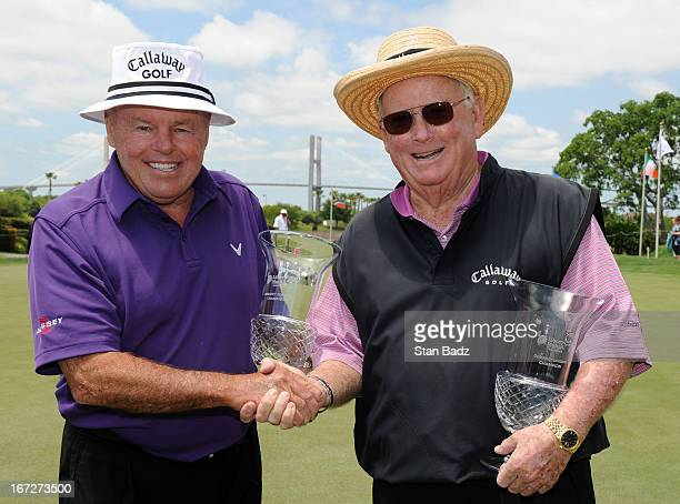 Jim Colbert and Bob Murphy pose with their trophies after defeating Larry Ziegler and Frank Beard in a onehole playoff during the final round of the...