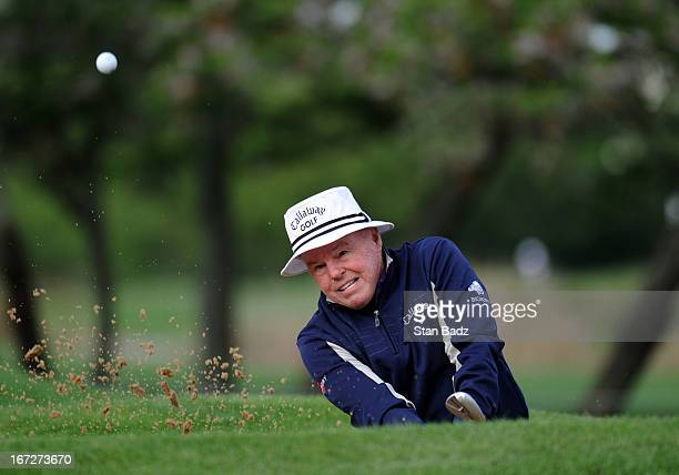 Jim Colbert hits from a bunker on the first hole during the final round of the Demaret Division at the Liberty Mutual Insurance Legends of Golf at...