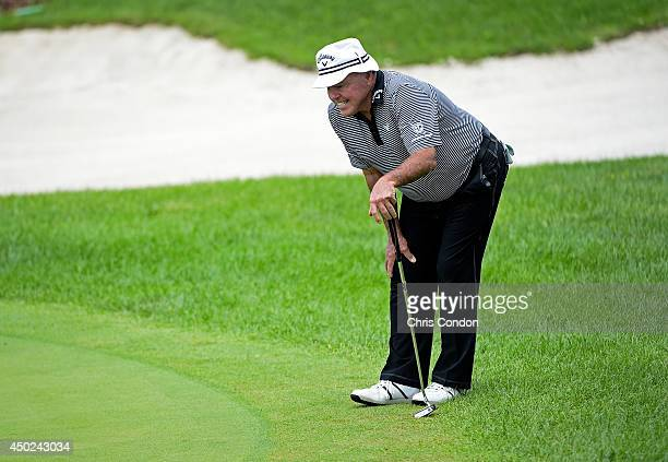 Jim Colbert lines up a birdie putt on the third green during the second round of the Big Cedar Lodge Legends of Golf presented by Bass Pro Shops at...